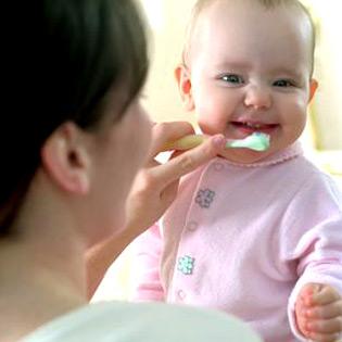 brushing babys teeth